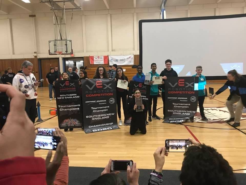 The Locke Monster Robotics 8025B Team (right) won the 2020 Southern New England Regional Championship.